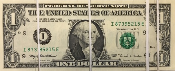 Dollar bill split to show portions of tax categories