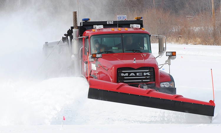 Image of a Carver County snow plow in action