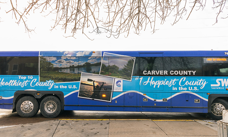 Photo of a bus branded with Carver County logo and images